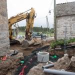 Mise en place du réseau eau pluviale + égouts sur la place du village